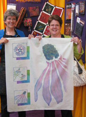 Shelly Stokes and Jane Barnett with Coneflower quilt top