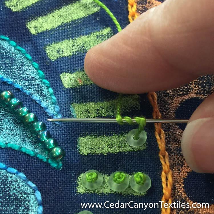 2: Wrap thread around the needle three times.